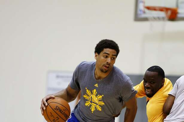 James Michael McAdoo handles the ball during practice at the Warriors' training facility in Oakland, California, on Tuesday, May 17, 2016.
