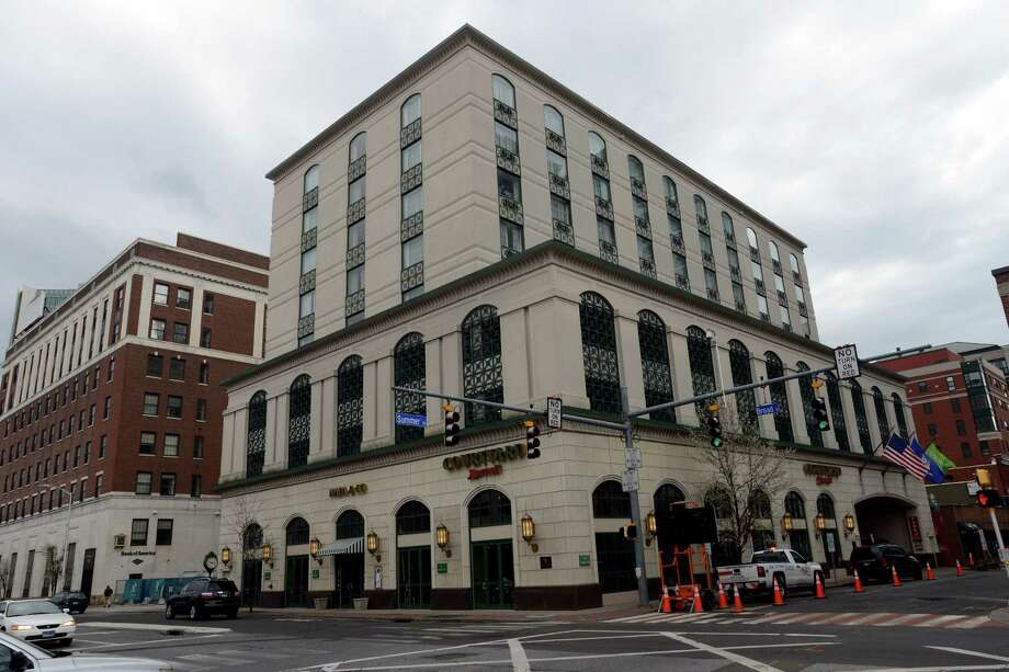 A starting bid price of $18 million has been set for the June 20 auction of this Summer Street building, in which the Courtyard by Marriott and other small business retailers lease space. Photo: Matthew Brown / Hearst Connecticut Media / Stamford Advocate