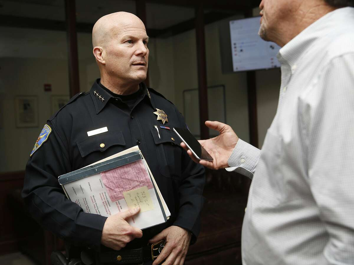 Chief Greg Suhr talks with reporter Chuck Nevius after the Chronicle editorial board at the Chronicle in San Francisco, California, on tuesday, may 17, 2016.