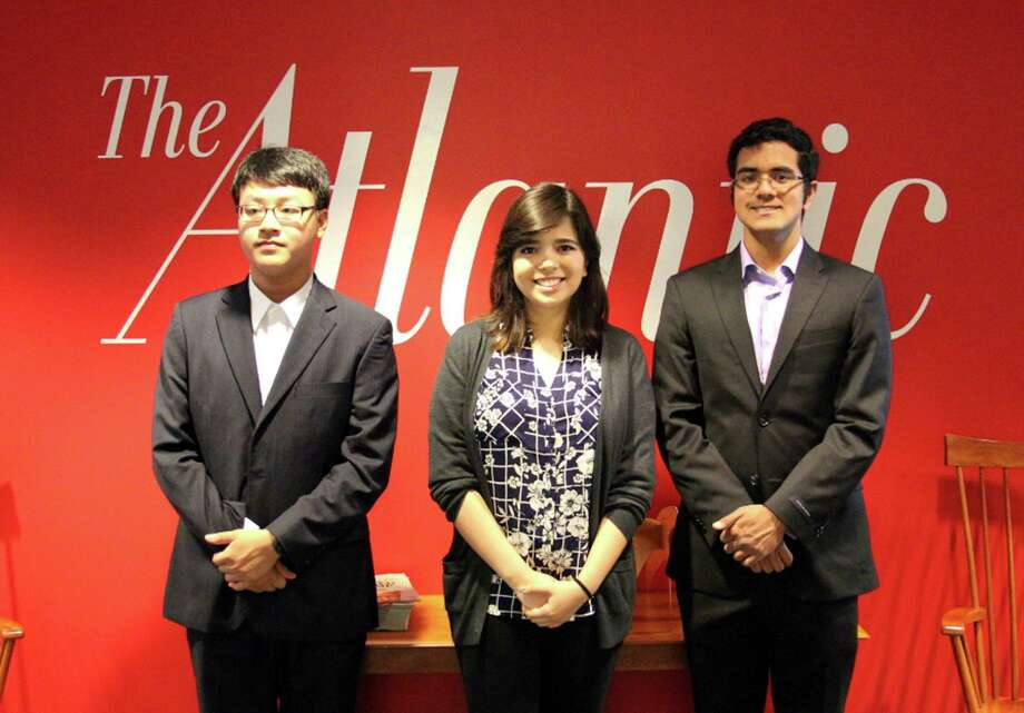 Danbury High School senior Rahul Malayappan, right, was a runner up in the College Board and The Atlantic magazine's writing contest. He is pictured with winner Thanh T. Nguyen, a high-school senior from Hanoi, Vietnam, left and other finalist Alejandra Canales of Laredo, Texas. Photo: Contributed Photo / Hearst Connecticut Media / The News-Times Contributed