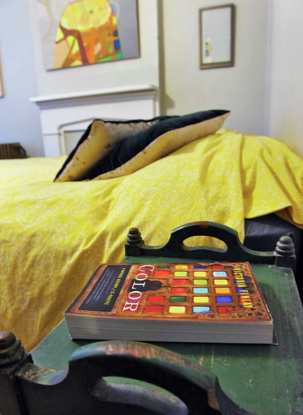 Night stand in the master bedroom of artist Jenny Kemp's 1842 row house Tuesday April 5, 2016 in Troy, NY. (John Carl D'Annibale / Times Union)