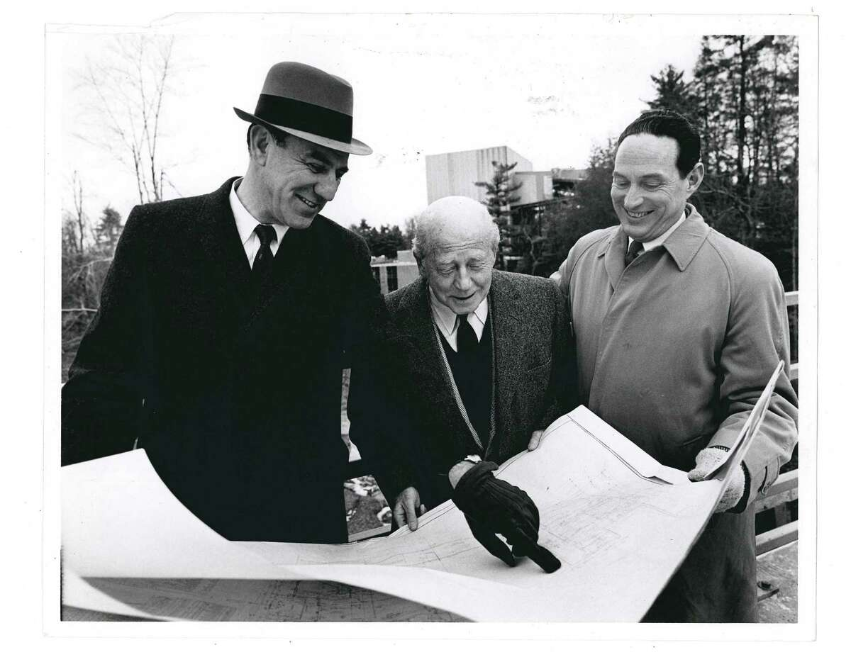 Lewis Swyer, Eugene Ormandy, Richard Leach with the plans for the SPAC construction. (Courtesy SPAC)