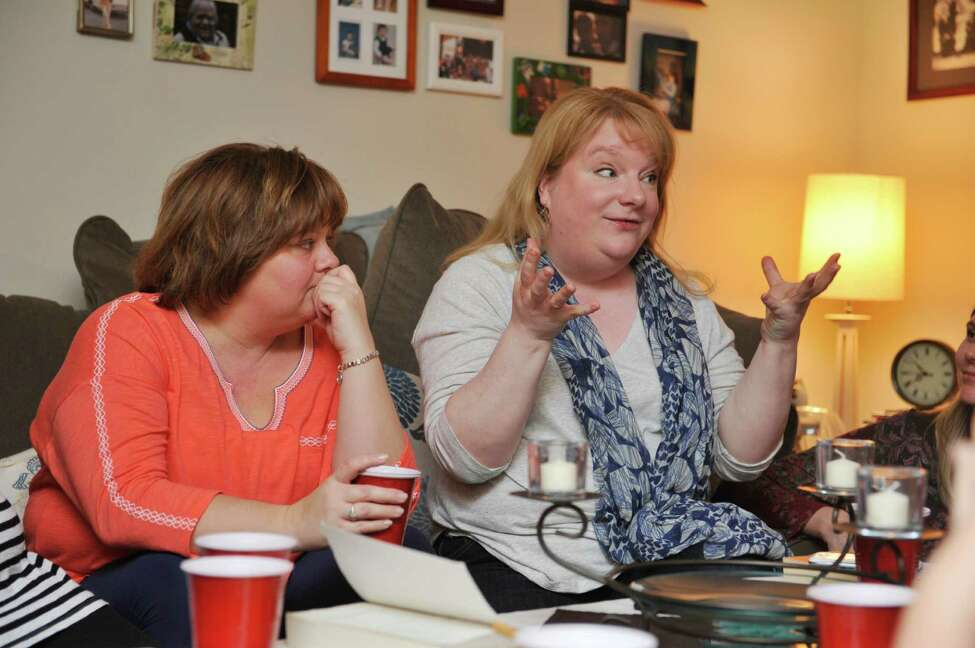 Janice Lutt, left, and Karen Good talk about the book Middle Age: A Romance by Joyce Carol Oates during their book club meeting on Sunday, Feb. 28, 2016, in Troy, N.Y. (Paul Buckowski / Times Union)