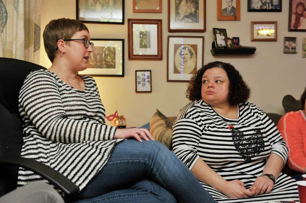 Erika Pangburn, left, and Lynette Williams talk about the book Middle Age: A Romance by Joyce Carol Oates during their book club meeting on Sunday, Feb. 28, 2016, in Troy, N.Y. (Paul Buckowski / Times Union)