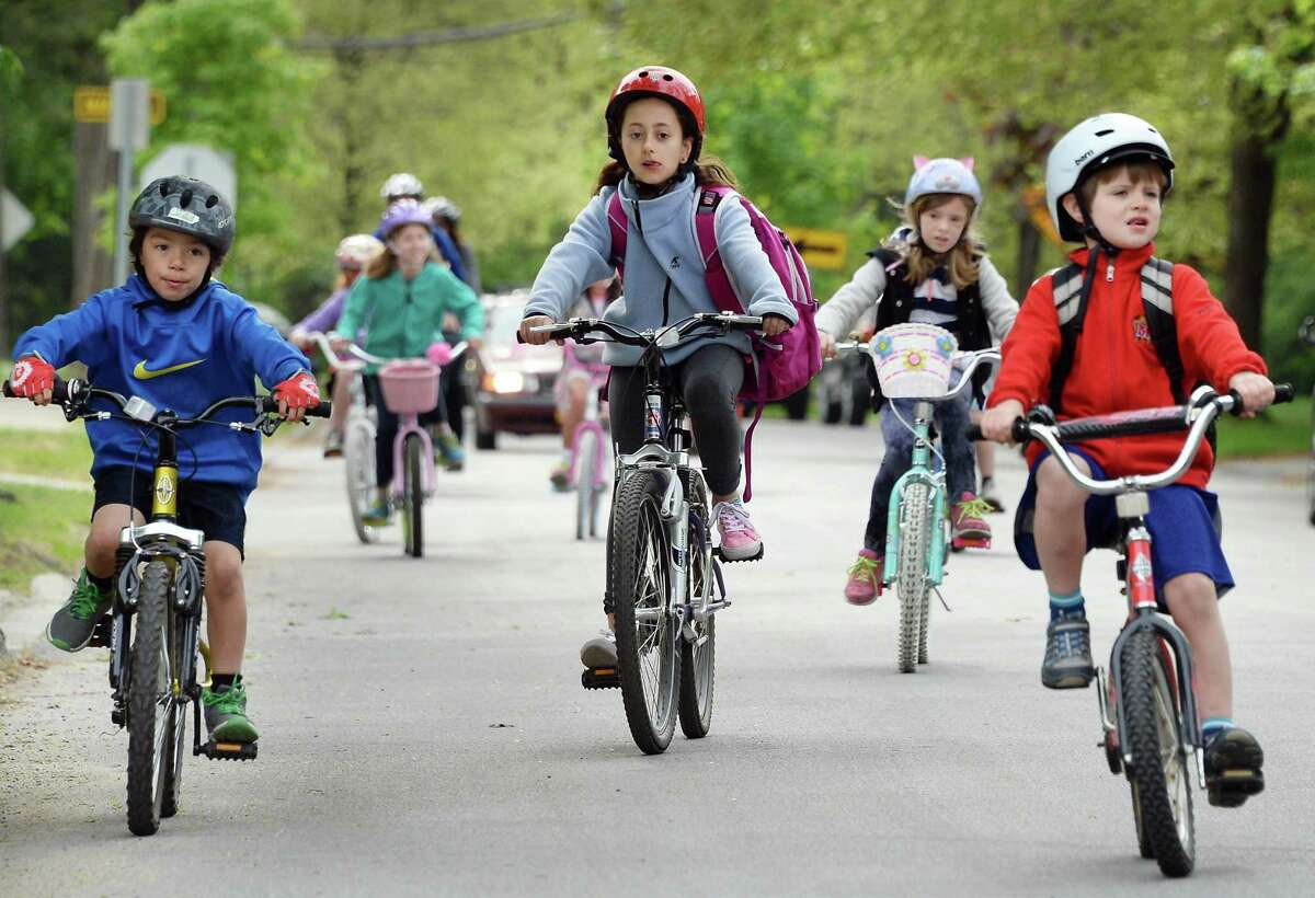 Lake Avenue Elementary School students bicycle to school on National Bike to Work Day Friday May 15, 2015 in Saratoga Springs, NY. (John Carl D'Annibale / Times Union)