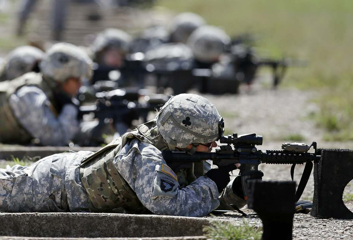 In this 2012 file photo, female soldiers from 1st Brigade Combat Team, 101st Airborne Division train on a firing range while testing new body armor in Fort Campbell, Ky.