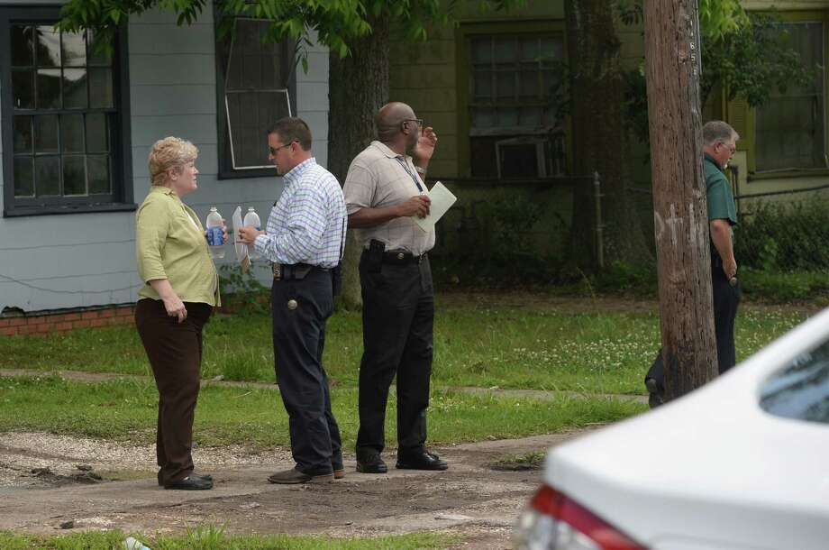 Emergency officials respond to a home on Pipkin Street Tuesday after reports of a three-year-old accidentally shooting themselves. The child was driven to a hospital with what police said was a gunshot would to the head. Police are investigating. Photo taken Tuesday May 17, 2016 Guiseppe Barranco/The Enterprise Photo: Guiseppe Barranco, Photo Editor