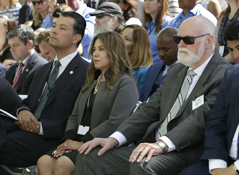 Secretary of State Alex Padilla (left), with Assemblywoman Nora Campos, D-San Jose, and state Sen. Jim Beall, D-San Jose, at a Peace Officers Memorial ceremony in Sacramento in May. Campos is running against Beall for his Senate seat and has won the backing of an oil-industry-backed campaign committee. Photo: Rich Pedroncelli, Associated Press