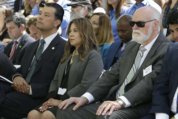 In this photo taken Monday, May 2, 2016, California Secretary of State Alex Padilla, left, Assemblywoman Nora Campos, D-San Jose, and Sen. Jim Beall, D-San Jose, attend the Peace Officers Memorial ceremony in Sacramento, Calif. The California Senate on Thursday, May 12, 2016, reversed the fundraising blackout it imposed after a series of ethical violations led to the suspension of three senators in 2014, a day before senators would have been forced to stop some fundraising just ahead of the June primary.  (AP Photo/Rich Pedroncelli)
