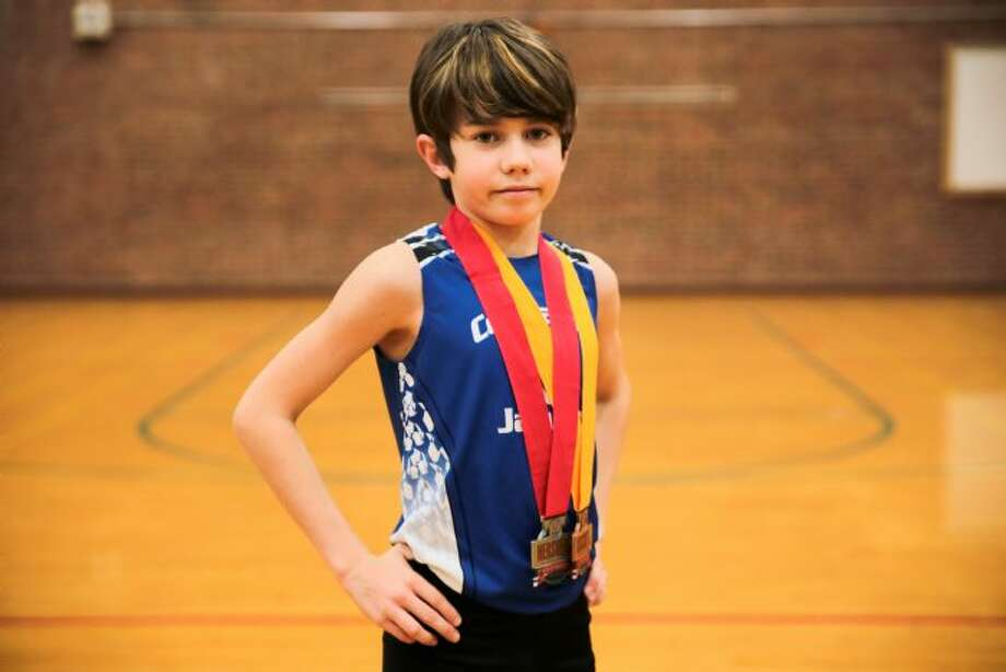 Aidan Puffer, of Manchester, CT set a new 11 year old 5k track WORLD record this past Saturday, May 14, 2016 with a time of 17:06.05 at the Battle Road Track Club Twilight Series 1 meet at Bentley University in Waltham, MA. Photo: Martha Puffer