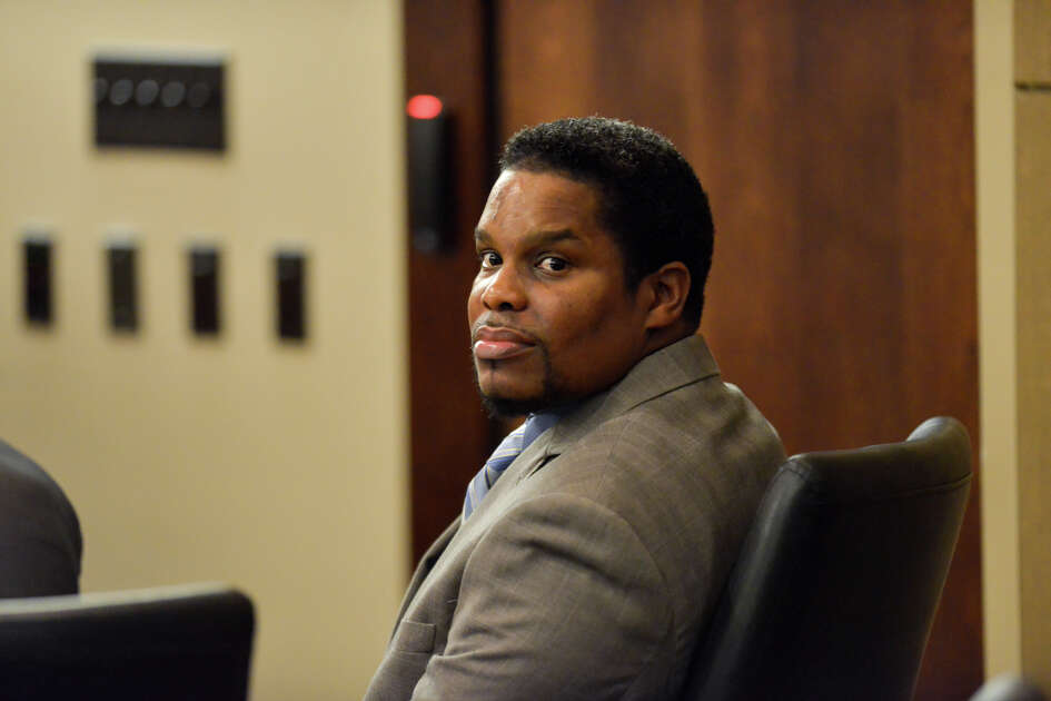 Former Bexar County Sheriff's deputy Anthony Lamont Thomas looks around State District Court 379 prior to the start of his murder trial Tuesday afternoon.