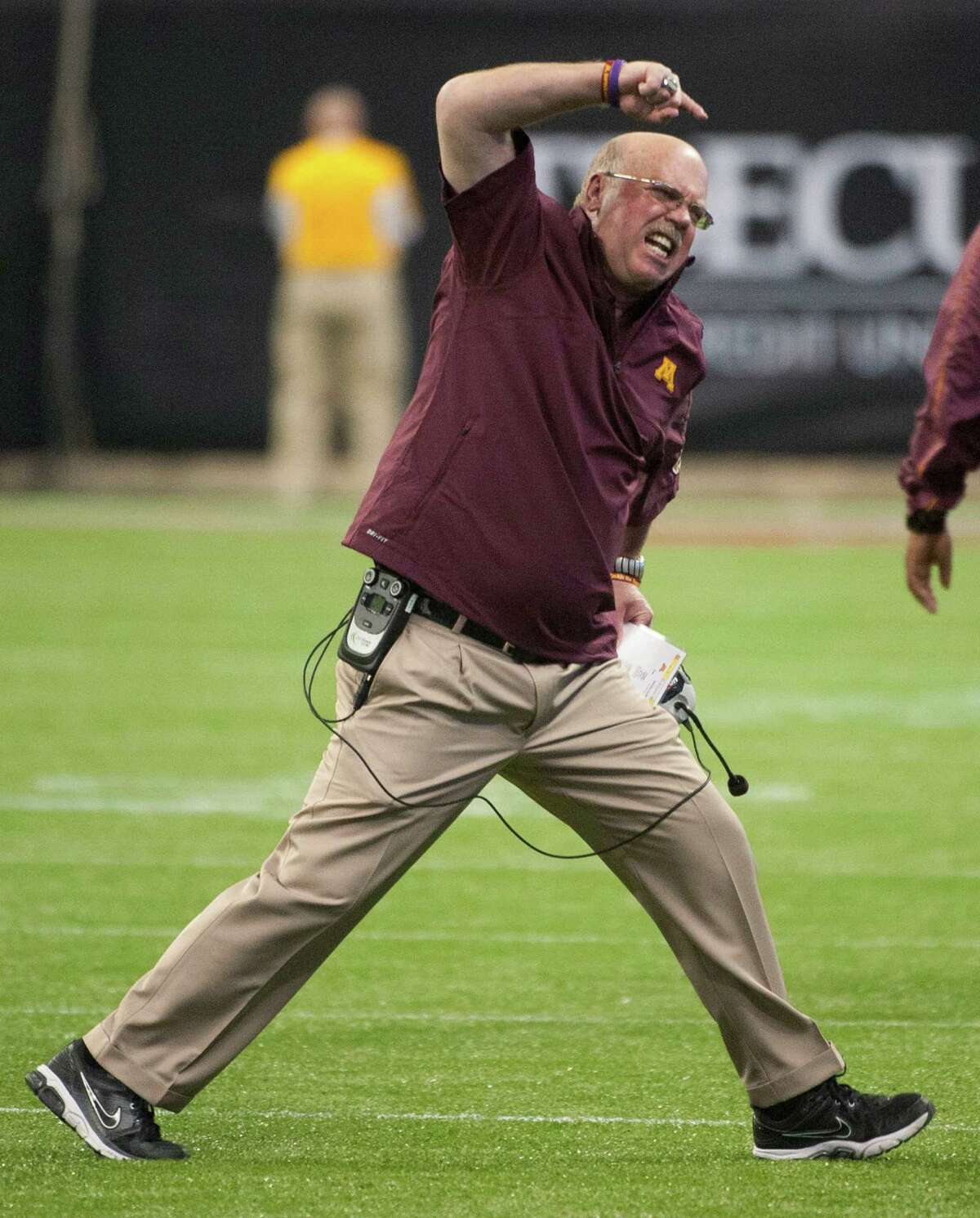 FILE - In this Dec. 28, 2012, file photo, Minnesota coach Jerry Kill reacts to a double penalty during the second quarter against Texas Tech in the Meineke Car Care Bowl NCAA college football game in Houston. Minnesota coach Jerry Kill is retiring because of health reasons, bringing to an abrupt end his efforts to rebuild the Golden Gopher football program. The surprising announcement came one day after Kill missed a scheduled meeting with the media. Kill has epilepsy, and had to take a leave of absence from the team in 2013 while dealing with seizures. (AP Photo/Dave Einsel, File)
