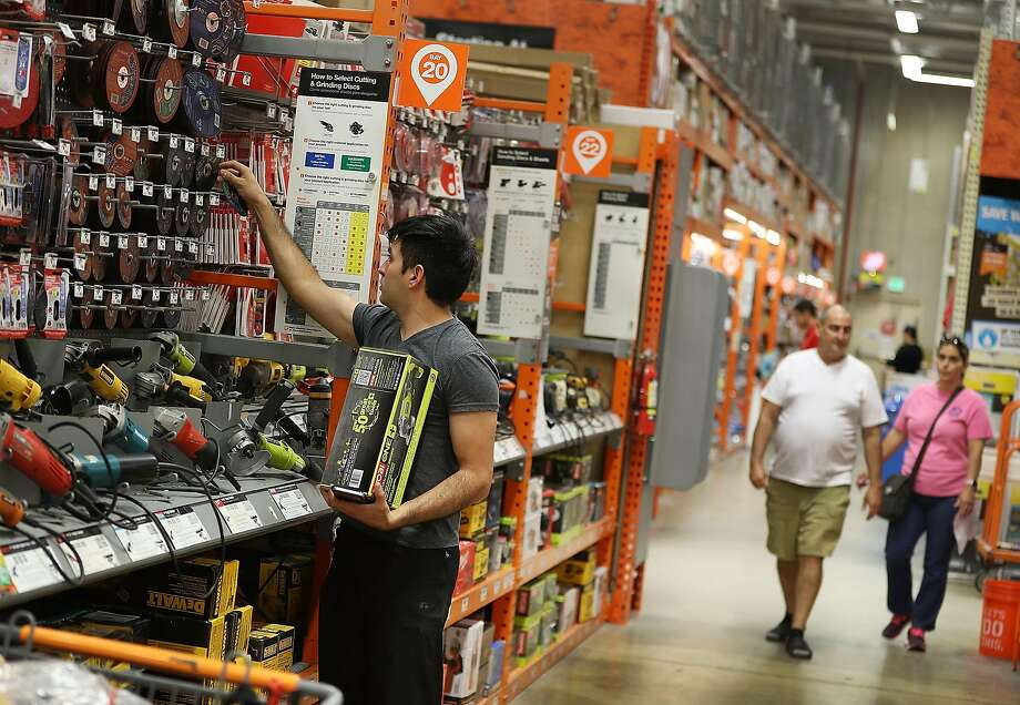 MIAMI, FL - MAY 17: Guido Rivadeneira (L) shops in a Home Depot store on May 17, 2016 in Miami, Florida. Home Depot raised its yearly outlook after first quarter sales figures showed the home improvement retailer had a net profit of $1.8 billion, or $1.44 share, compared with $1.58 billion, or $1.21 a share, a year ago. (Photo by Joe Raedle/Getty Images) Photo: Joe Raedle, Getty Images