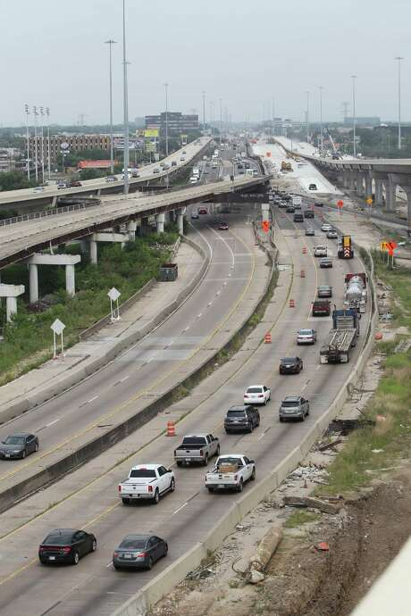 "An overview of the TxDOT construction of westbound US 290  Wednesday, May 11, 2016, in Houston.  TxDOT will make a major traffic switch this weekend, changing the way drivers get from northbound Loop 610 to U.S. 290. ""We will switch the exit to US 290 from its current location on the left side of the freeway to the right side of the freeway.  The exit will be placed on a portion of the new IH 10 to US 290 connector, the part that is completed is from about W. 18th Street over to US 290.  So we'll move the US 290 exit to that portion of the connector with a temporary transition from the right side of IH 610 to the connector.  What this does is open up the US 290 westbound mainlanes from IH 610 to about W. 34th for crews to work on.""  ( Steve Gonzales  / Houston Chronicle  ) Photo: Steve Gonzales / © 2016 Houston Chronicle"