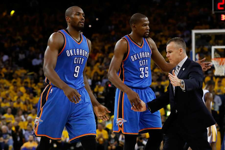 OAKLAND, CA - MAY 16:  Billy Donovan of the Oklahoma City Thunder high fives Serge Ibaka #9 and Kevin Durant #35 during game one of the NBA Western Conference Finals against the Golden State Warriors at ORACLE Arena on May 16, 2016 in Oakland, California. NOTE TO USER: User expressly acknowledges and agrees that, by downloading and or using this photograph, User is consenting to the terms and conditions of the Getty Images License Agreement.  (Photo by Christian Petersen/Getty Images) Photo: Christian Petersen, Getty Images