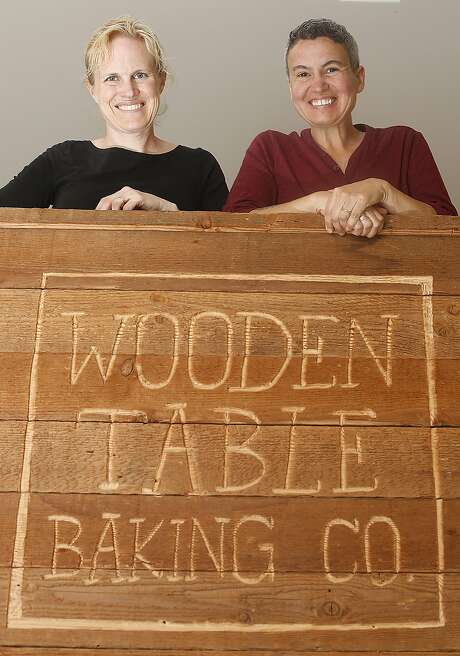 Director of marketing Citabria Ozzuna (left) and owner Andreas Ozzuna at the Wooden Table Baking company in Oakland. Photo: Liz Hafalia, The Chronicle
