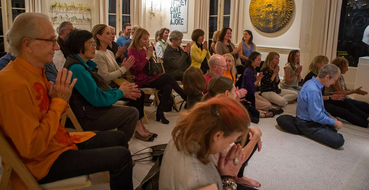 A group of friends gather in the home of Norman and Norah Stone to listen to the guided meditation session by Orgyen Chowang Rinpoche.