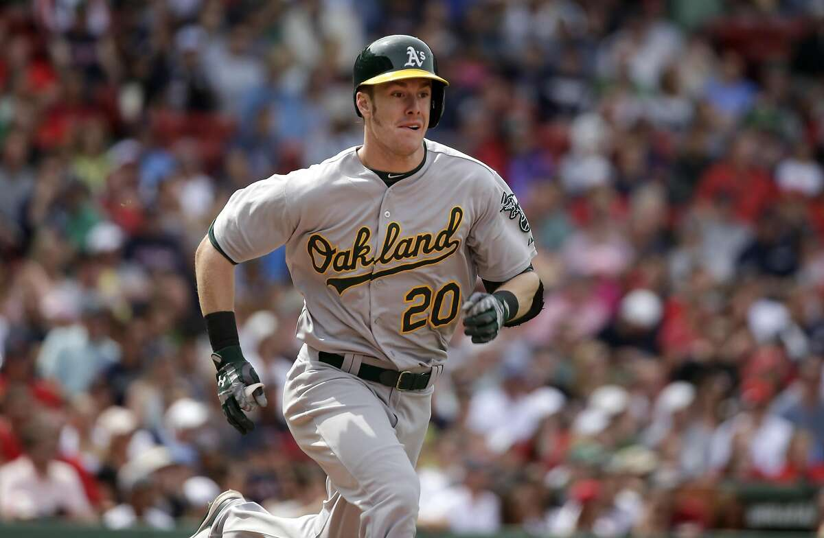 Oakland Athletics' Mark Canha runs to first base after hitting a single off a pitch by Boston Red Sox's Clay Buchholz in the fifth inning of a baseball game, Sunday, June 7, 2015, in Boston. (AP Photo/Steven Senne)