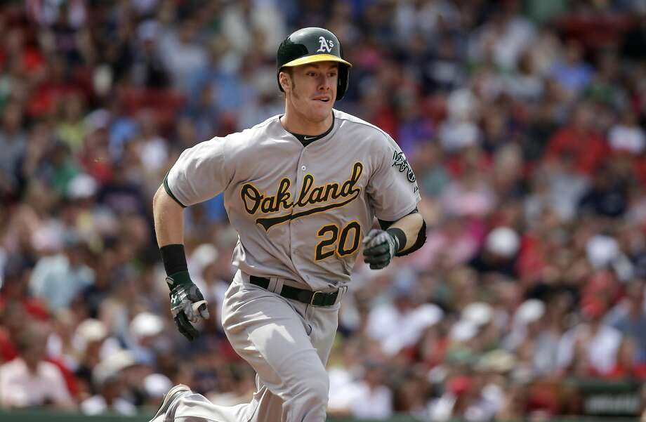 Oakland Athletics' Mark Canha runs to first base after hitting a single off a pitch by Boston Red Sox's Clay Buchholz in the fifth inning of a baseball game, Sunday, June 7, 2015, in Boston. (AP Photo/Steven Senne) Photo: Steven Senne, Associated Press