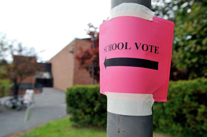 A sign is posted to a pole outside Albany High School as voting on school budgets took place on Tuesday, May 17, 2016, in Albany, N.Y. (Paul Buckowski / Times Union)
