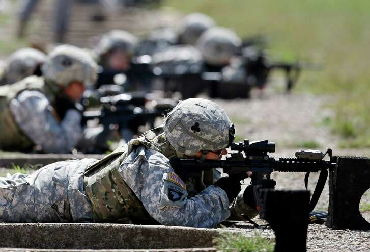 Female soldiers train on a firing range while testing body armor in Fort Campbell, Ky., in 2012. (Mark Humphrey / Associated Press file)
