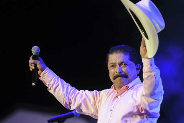 Emilio Navaira acknowledges applause after performing at the Tejano Music Awards at the Alamodome on Saturday, Aug. 18, 2012. He died in New Braunfels on Thursday.