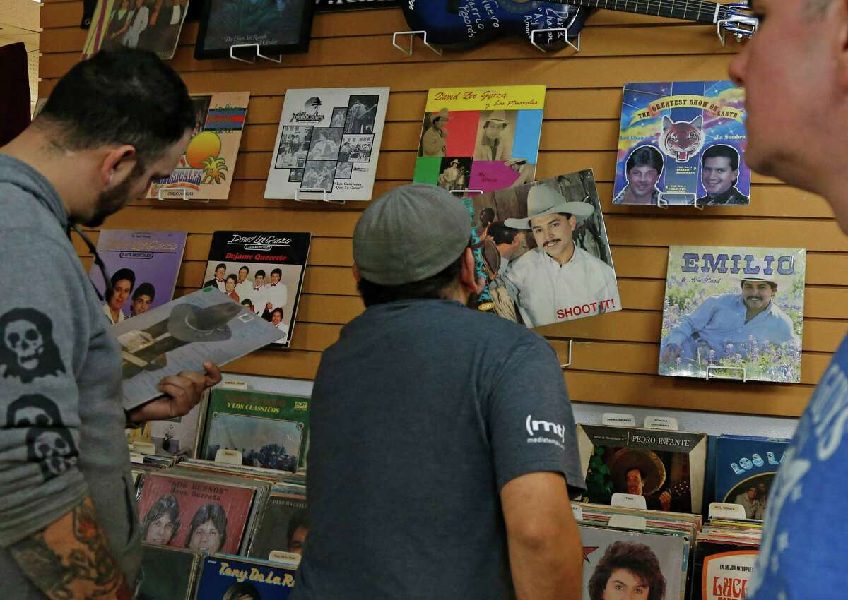 George Mendoza checks out one of Emilio Navaira album covers at Janie's Record Shop on Tuesday.