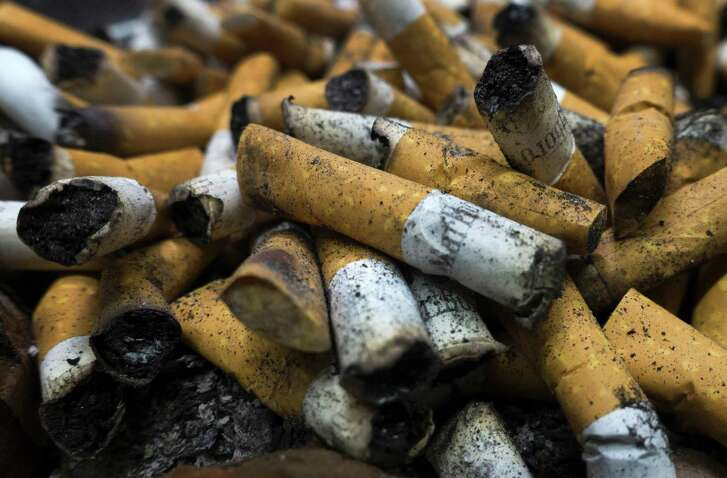 "(FILES) This file photo taken on April 18, 2016 shows cigarettes in an ashtray on April  in Centreville, Virginia.  The US Supreme Court on May 16, 2016 refused to hear an appeal by tobacco giant Philip Morris USA which had been ordered to pay $25 million to a man whose wife died of cancer. The high court upheld the ruling by the court of appeals in the northwestern state of Oregon that had cited Philip Morris' ""extreme reprehensibility.""  / AFP PHOTO / PAUL J. RICHARDSPAUL J. RICHARDS/AFP/Getty Images"