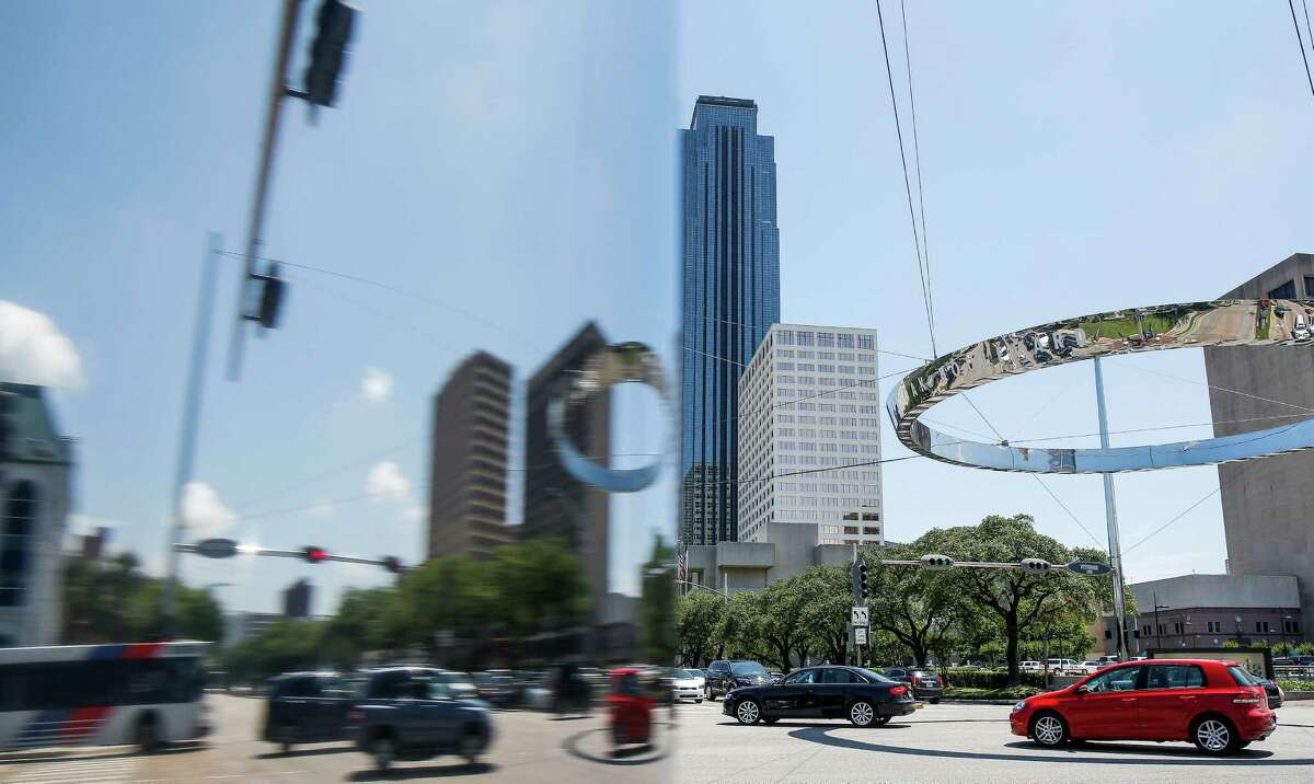 Traffic moves through the intersection at Post Oak Boulevard and Westheimer Road Tuesday, May 17, 2016 in Houston.