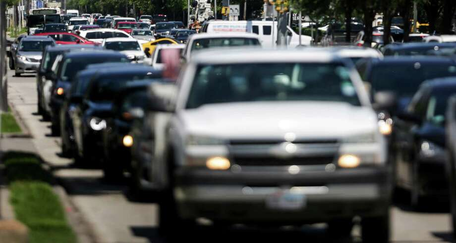 Traffic moves through the intersection at Post Oak Boulevard and Westheimer Road Tuesday, May 17, 2016 in Houston. Photo: Michael Ciaglo, Houston Chronicle / © 2016  Houston Chronicle