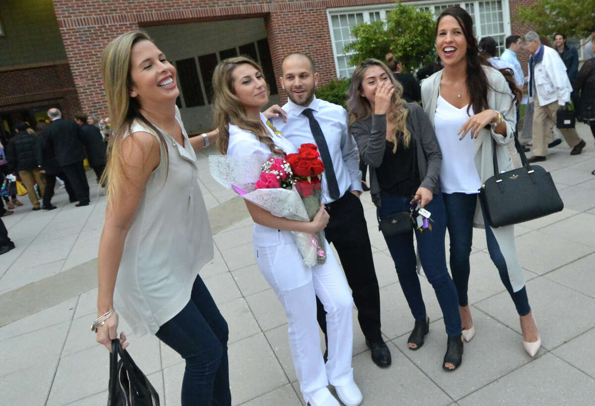 Graduate Alexis Navarro from Stratford poses for a photo with friends after the Norwalk Community College Nursing Class of 2016 Pinning Ceremony at City Hall in Norwalk Conn. Tuesday May 17, 2016