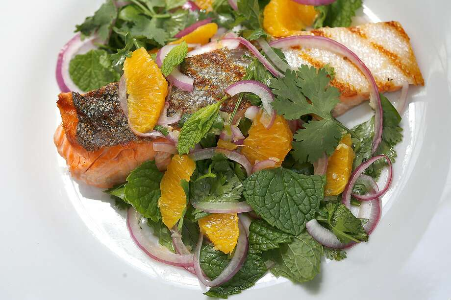 Yam Pla, made here with local salmon, is a Thai fish salad that is a great way to use seasonal seafood. Photo: Liz Hafalia, The Chronicle