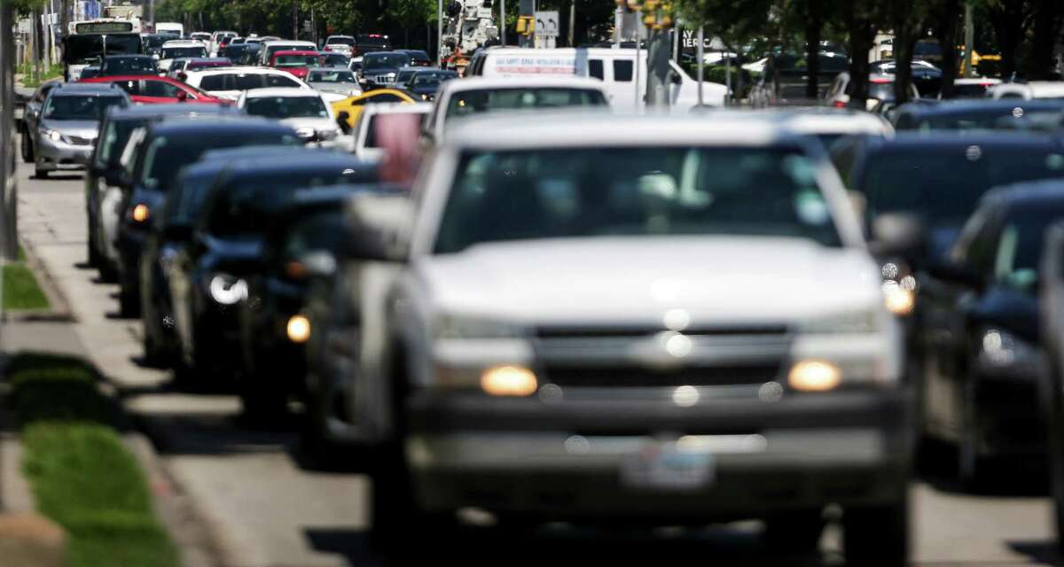 Traffic moves through the intersection at Post Oak Boulevard and Westheimer on May 17. A dedicated bus lane, funded with both state and federal money, is planned to help ease congestion.