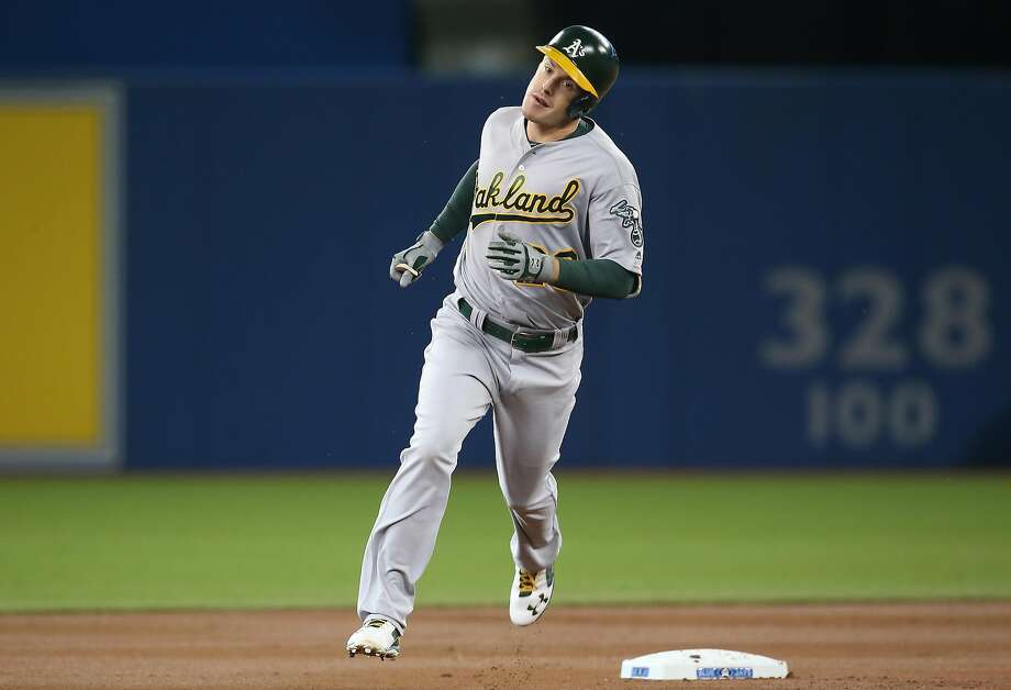 Mark Canha of the Oakland Athletics circles the bases after hitting a solo home run in the first inning during MLB game action against the Toronto Blue Jays on April 23, 2016 at Rogers Centre in Toronto, Ontario, Canada. Photo: Tom Szczerbowski, Getty Images