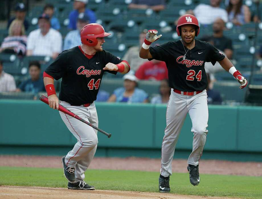 Houston infielder Corey Julks (24) celebrates his run scored with Joe Davis (44) on Houston's Jacob Campbell's two-run single during the fourth inning of a college baseball game at Constellation Field Tuesday, May 17, 2016, in Sugar Land. Photo: Karen Warren, Houston Chronicle / © 2016 Houston Chronicle