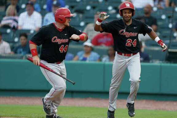 Houston infielder Corey Julks (24) celebrates his run scored with Joe Davis (44) on Houston's Jacob Campbell's two-run single during the fourth inning of a college baseball game at Constellation Field Tuesday, May 17, 2016, in Sugar Land.