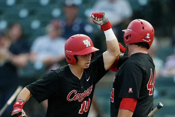 Houston outfielder Connor Wong (10) celebrates his home run with teammate Joe Davis (44) during the fourth inning of a college baseball game at Constellation Field Tuesday, May 17, 2016, in Sugar Land.