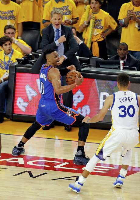 Warriors coach Steve Kerr, back, wanted a traveling call, but the Thunder's Russell Westbrook (0) was awarded a timeout late in Monday's Game 1 matchup. Photo: Scott Strazzante, Staff Photographer / ONLINE_YES