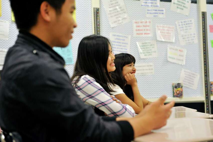 Albany High School refugee students, Shar Reh, left, Say Htoo, center, and Uma Siwakoti talk with English teacher Brian Huskie on Tuesday, May 17, 2016, in Albany, N.Y. (Paul Buckowski / Times Union)