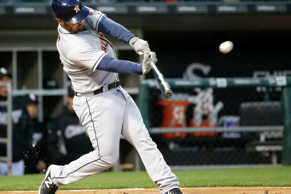 Houston Astros' Tyler White hits a home run off Chicago White Sox starting pitcher Carlos Rodon during the fourth inning of a baseball game Tuesday, May 17, 2016, in Chicago. (AP Photo/Charles Rex Arbogast)