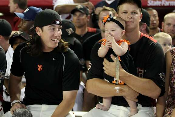 PHOENIX, AZ - JULY 11:  National League All-Star Tim Lincecum #55 of the San Francisco Giants sits with teammate Matt Cain #18 and his daughter Hartley during the 2011 State Farm Home Run Derby at Chase Field on July 11, 2011 in Phoenix, Arizona.  (Photo by Christian Petersen/Getty Images)