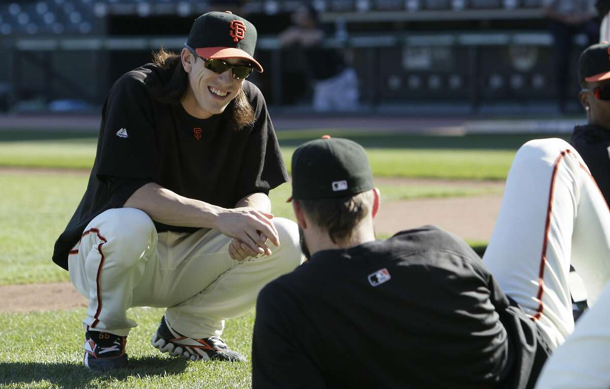 San Francisco Giants' Tim Lincecum, left, talks with Brian Wilson during a baseball workout in San Francisco, Wednesday, Oct. 13, 2010. The Giants face the Philadelphia Phillies in Game 1 of baseball's National League Championship Series on Saturday, in Philadelphia.