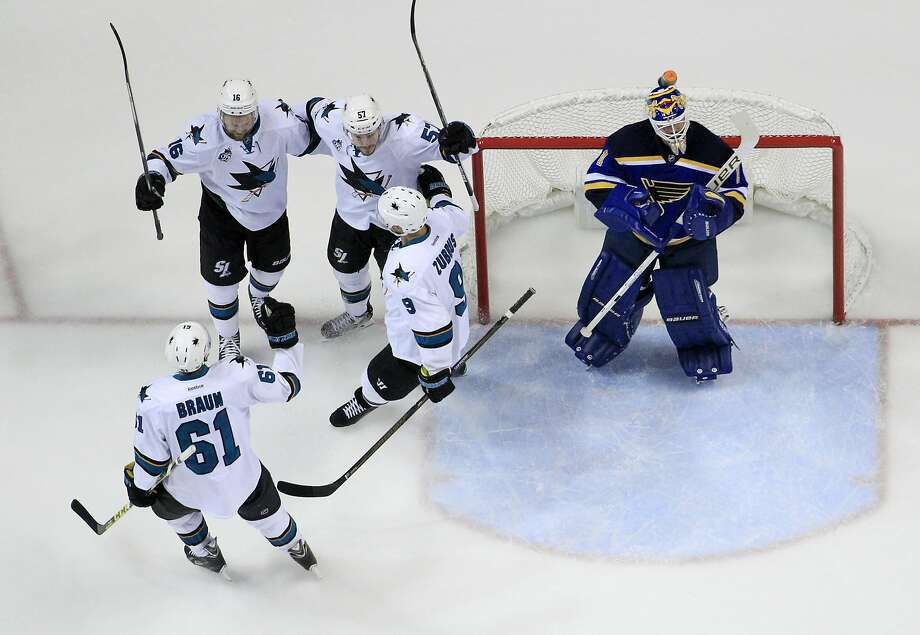 San Jose Sharks center Tommy Wingels (57) celebrates with his teammates defenseman Justin Braun (61), center Nick Spaling (16) and right wing Dainius Zubrus (9) after scoring a goal against St. Louis Blues goalie Brian Elliott (1) during the first period in Game 2 of the NHL hockey Stanley Cup Western Conference finals, Tuesday, May 17, 2016, in St. Louis. (AP Photo/Jeff Roberson) Photo: Jeff Roberson, Associated Press