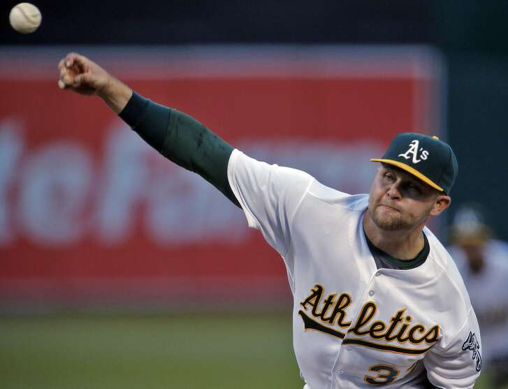 Jesse Hahn (32) delivers a pitch in the second inning as the Oakland Athletics played the Texas Rangers at the Oakland Coliseum in Oakland, Calif., on Tuesday, May 17, 2016.