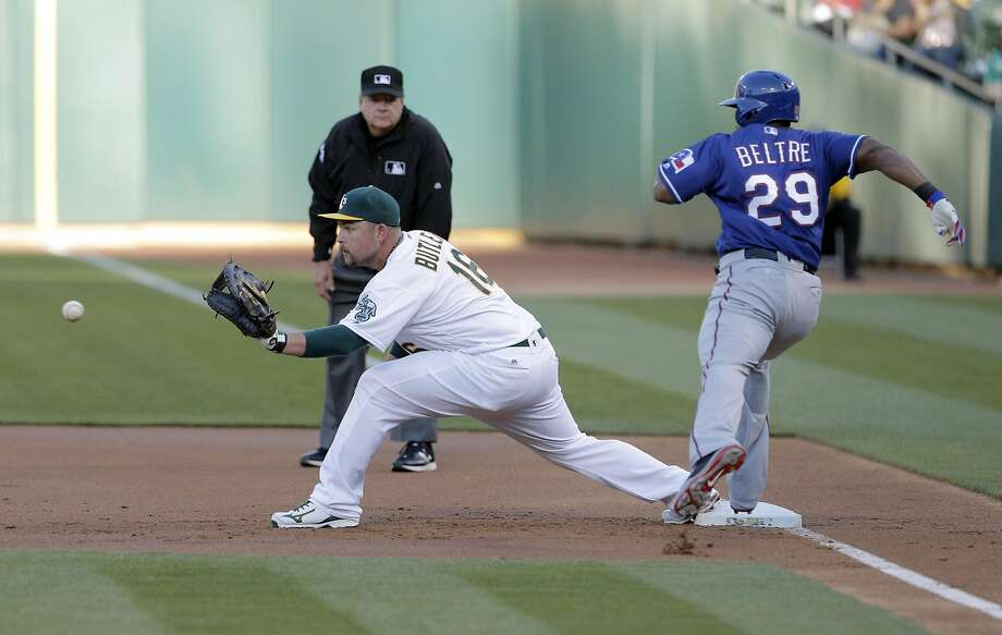 Billy Butler (16) waits for the throw from Marcus Semien (10) on a ball hit by Adrian Beltre (29) in the first inning as the Oakland Athletics played the Texas Rangers at the Oakland Coliseum in Oakland, Calif., on Tuesday, May 17, 2016. Photo: Carlos Avila Gonzalez, The Chronicle