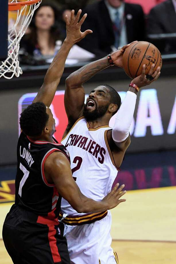 CLEVELAND, OH - MAY 17: Kyrie Irving #2 of the Cleveland Cavaliers drives to the basket in the first quarter against Kyle Lowry #7 of the Toronto Raptors in game one of the Eastern Conference Finals during the 2016 NBA Playoffs at Quicken Loans Arena on May 17, 2016 in Cleveland, Ohio. NOTE TO USER: User expressly acknowledges and agrees that, by downloading and or using this photograph, User is consenting to the terms and conditions of the Getty Images License Agreement.  (Photo by Jason Miller/Getty Images) ORG XMIT: 640105339 Photo: Jason Miller / 2016 Getty Images