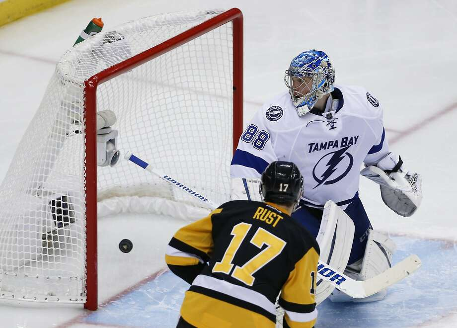 The Penguins' Sidney Crosby's shot in overtime gets by Tampa Bay goalie Andrei Vasilevskiy for the winning goal in Game 2. Photo: Gene J. Puskar, Associated Press