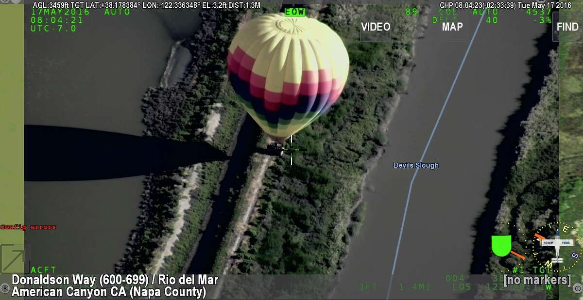 The California Highway Patrol rescued 17 people stuck after a hot air balloon landed on a small strip of land surrounded by sloughs and ponds on Tuesday May 17, 2016.
