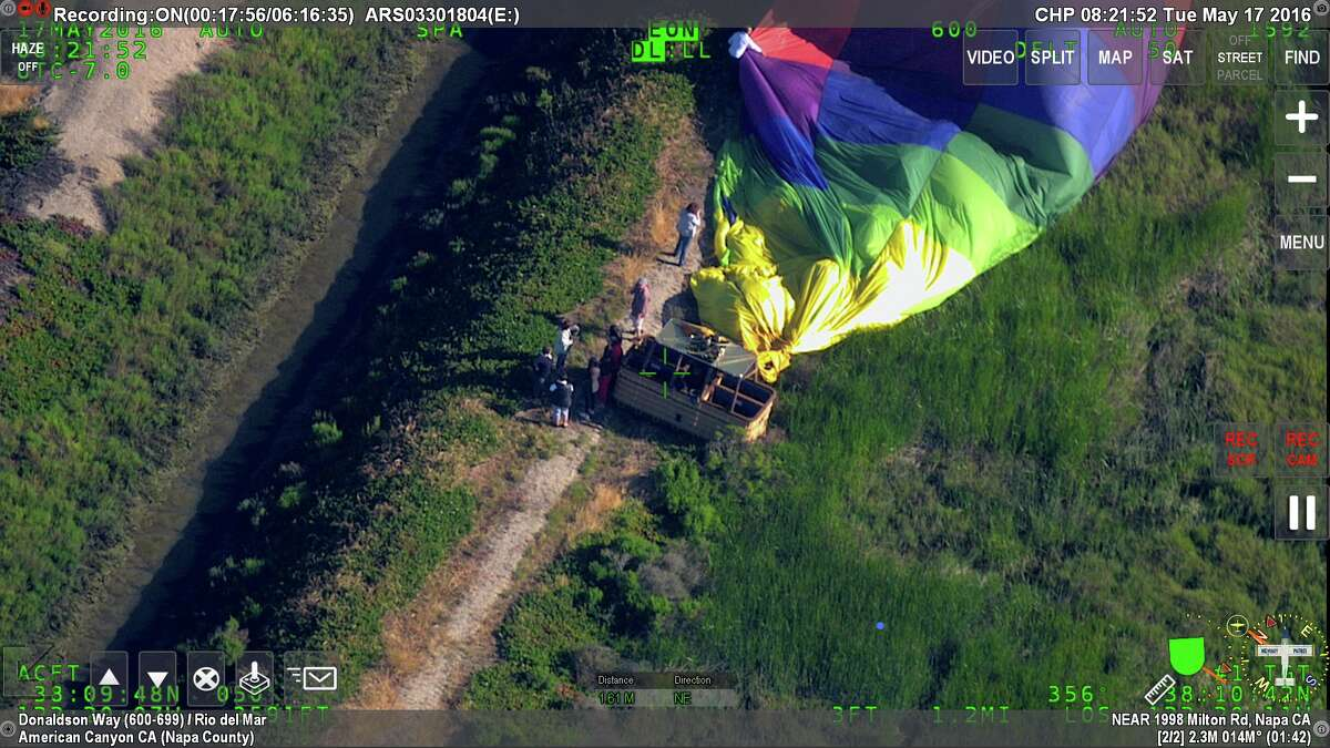 California Highway Patrol rescued 17 people stuck after a hot air balloon landed on a small strip of land surrounded by sloughs and ponds on Tuesday May 17, 2016.