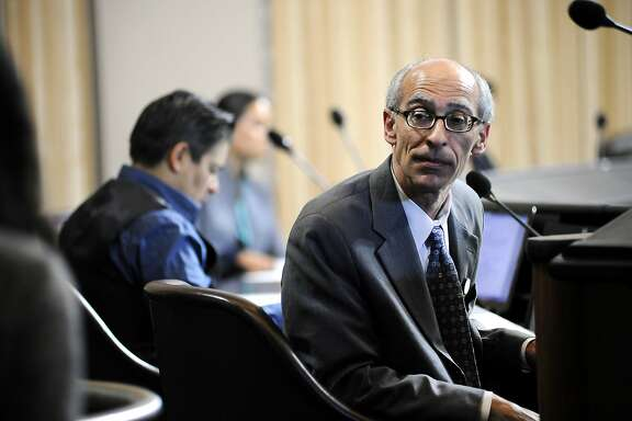 Council member Dan Kalb of District 1 listens to a member of the public give comments during an Oakland City Council held at City Hall in Oakland, CA Wednesday, July 7, 2015.